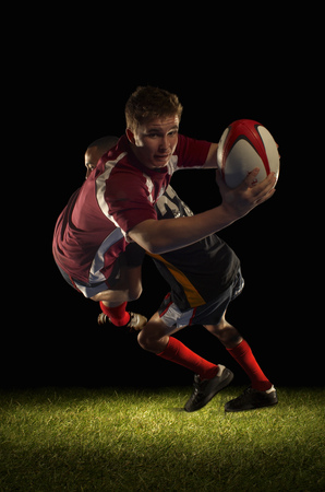 Rugby player being tackled and scoring LANG_EVOIMAGES