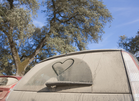mischievious: Car with heart shape drawn in dirt