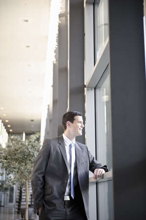 viewed: Businessman looking out office window