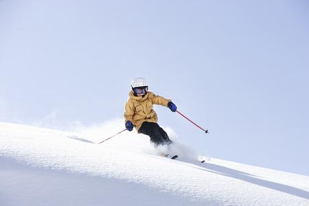 exhilarating: Young boy skiing through fresh powder