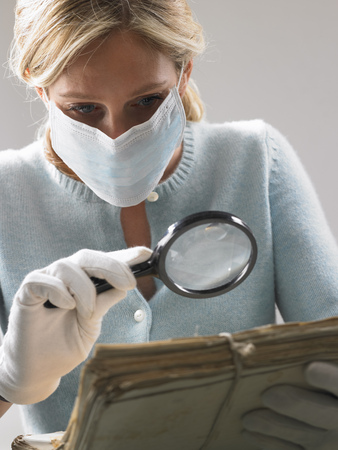 histories: Woman with mask and magnifying glass