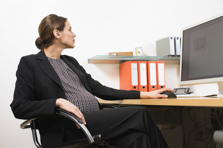 strategize: Pregnant business woman