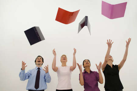 prevailing: Jubilant business people throw folders LANG_EVOIMAGES