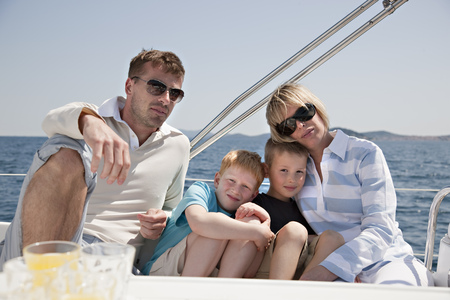 cherished: Family sitting together on yacht