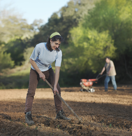 Man and woman preparing soil for sowing LANG_EVOIMAGES
