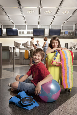 enthusiastically: Children waiting at airport checkin