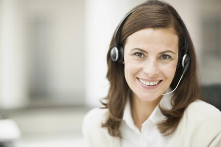 handsfree telephones: Portrait of a receptionist