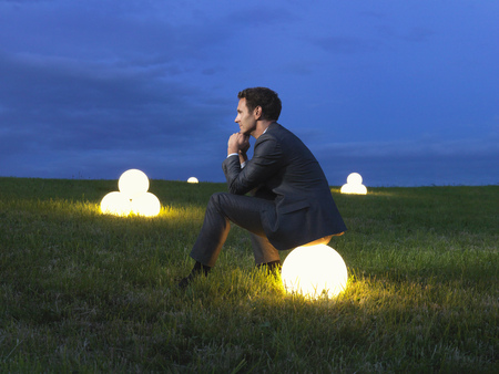 Man sitting on a lightball