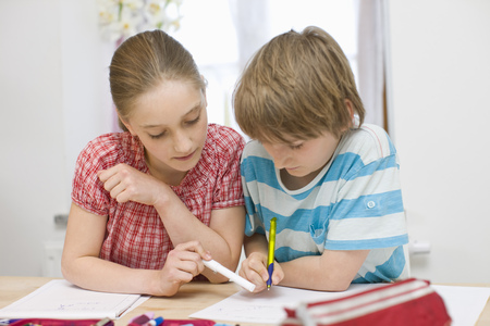 taught man: Boy and girl doing homework