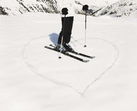 ceasing: Heart shape in snow with woman skier