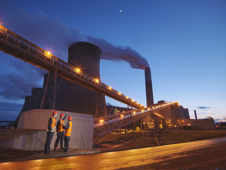 Workers With Power Station At Night