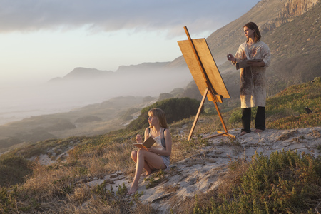 Young man and woman painting LANG_EVOIMAGES