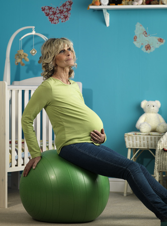 Pregnant older woman exercising LANG_EVOIMAGES