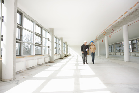 Two architects walking through site