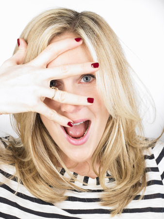 mischievious: Woman hiding her eyes with her hand