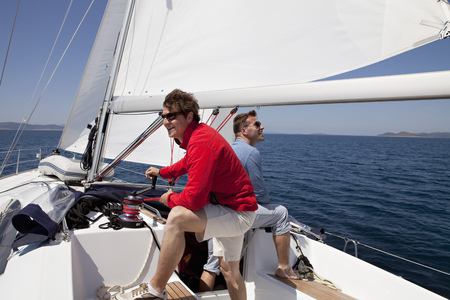 Two men setting sail on yacht