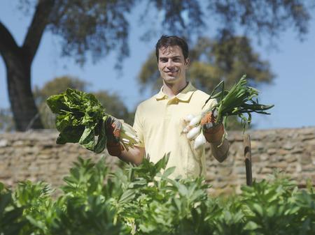 Man showing freshly picked vegetables