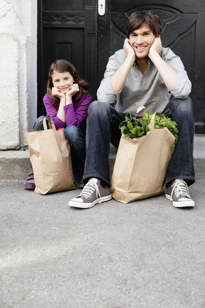 Father and girl shopping groceries