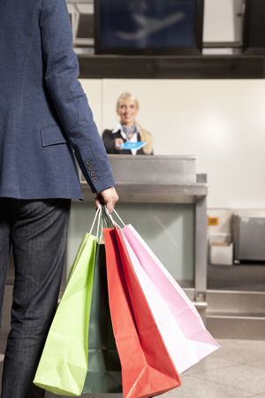 help section: Woman with shopping bags traveling