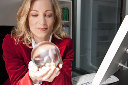 strategize: Businesswoman holding a crystal ball