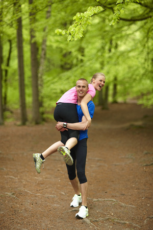 Couple running in forest, having fun