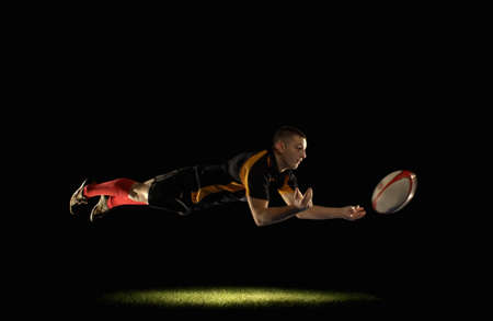 spotlight: Rugby player diving and passing LANG_EVOIMAGES