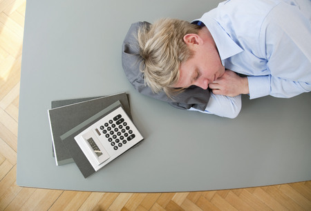 budgets: Businessman sleeping on conference table
