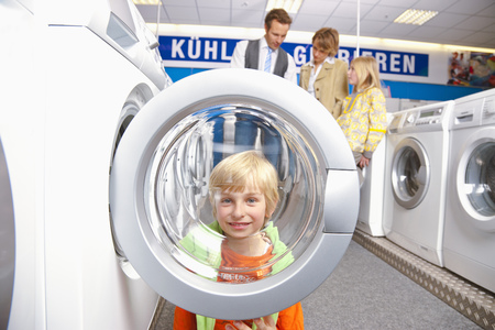 mischeif: Boy looking through machines bulls eye LANG_EVOIMAGES