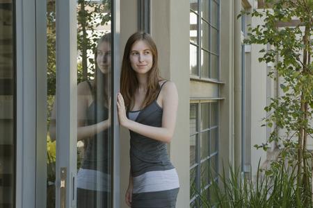 abodes: Young woman walking through door