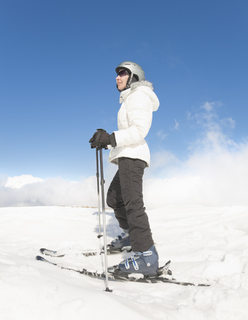 Woman Standing wearing Skis LANG_EVOIMAGES