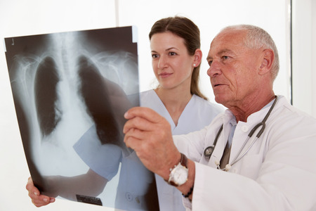conferring: Doctor and nurse looking at x-ray
