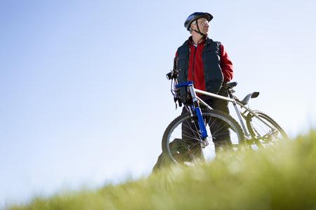 Senior man with mountain bike