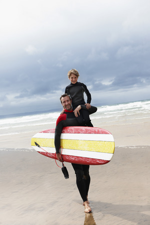 taught man: Father and son surfing LANG_EVOIMAGES