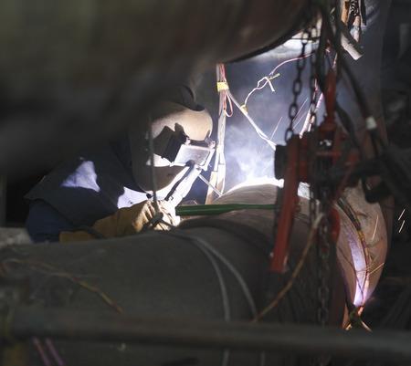 Worker welding in a power station