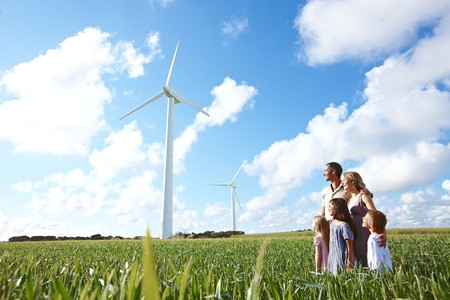 Family looking at wind turbines LANG_EVOIMAGES