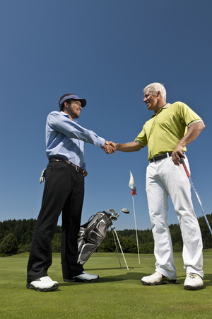 Golfer and caddy shaking hands