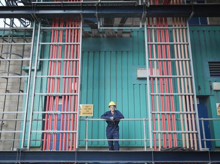 scaffolds: Worker in coal fired power station