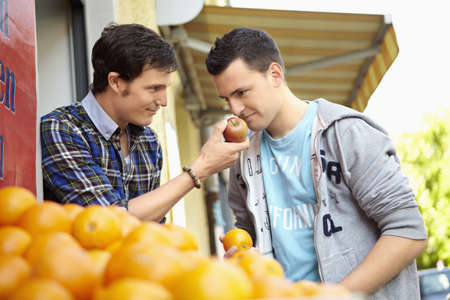 purchased: Young people buying fruits and vegetable