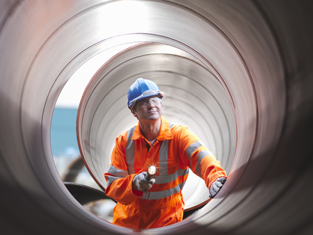 arms trade: Man checking pipes