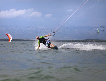 Kitesurfer speeding