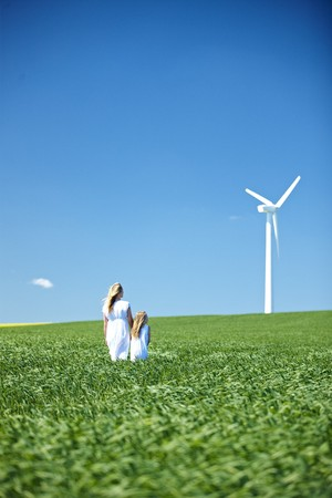 Wind turbine,mother and daughter LANG_EVOIMAGES