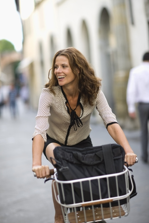 carryall: Woman on a bike