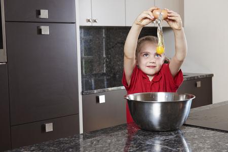 adds: Girl cracking egg over bowl