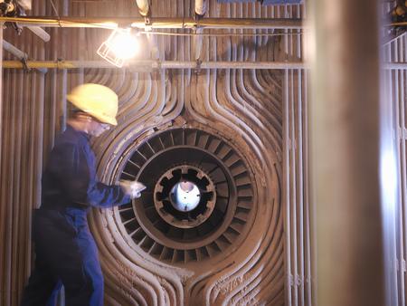 Worker reparaing a furnace