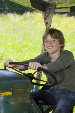 guides: Boy on truck, proud