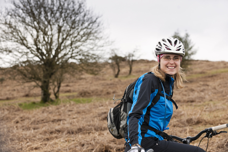 Woman with bike in countryside