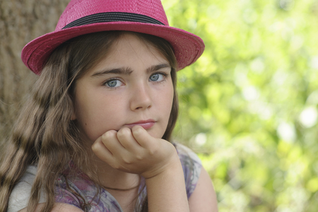 Portrait of young girl in pink hat