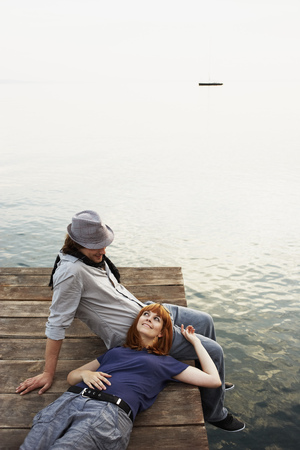 Couple resting on jetty