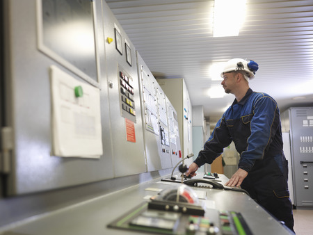 mans watch: Engineer in Control Room of Ship
