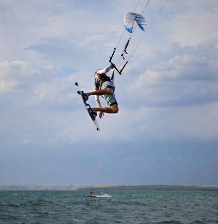 feats: Kitesurfer jumping